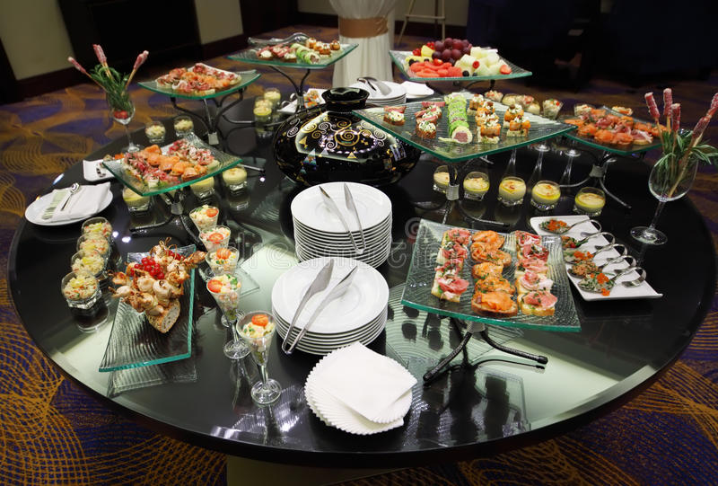Download Table With Cold Snacks And Tableware Stock Photo - Image: 20917936