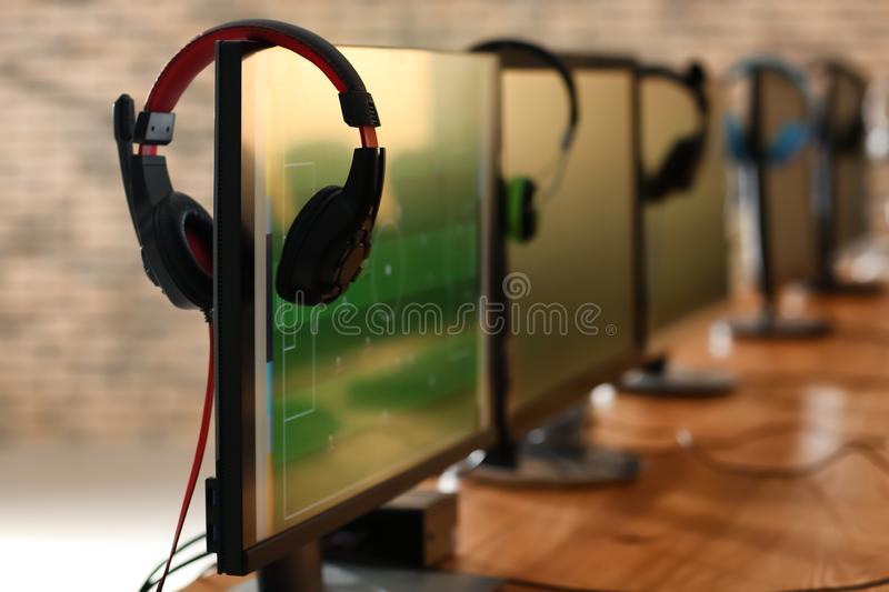 Table with computers for video games tournament stock image