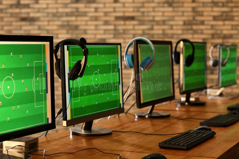 Table with computers for video games tournament stock photography