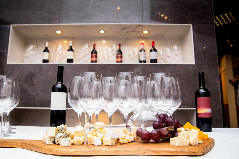 The table is covered with appetizers and glasses for wine stock photo