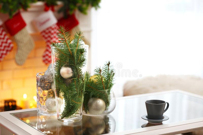 download table with cup vases and christmas decor stock photo image of holiday