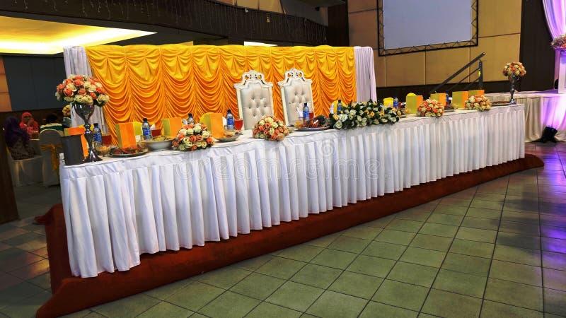 Table de salle à manger traditionnelle malaise de luxe de mariage de la prévoyance image libre de droits