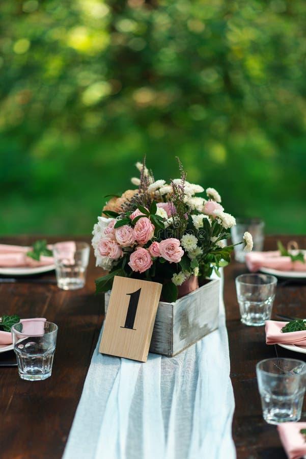 Table decoration with number. Elegant wedding table arrangement, floral decoration, restaurant. stock photography