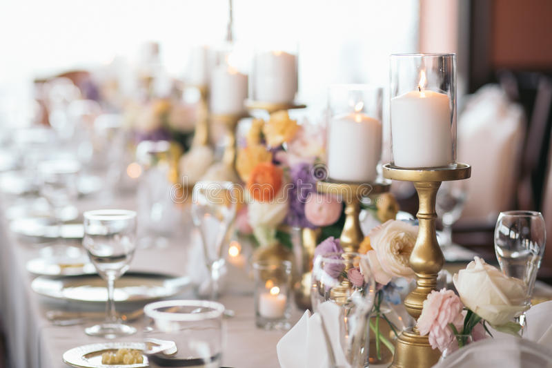Table Decorations. Lit Candles. Flowers. stock photo