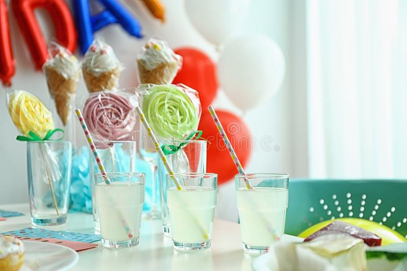Table with delicious treats and blurred balloons royalty free stock images