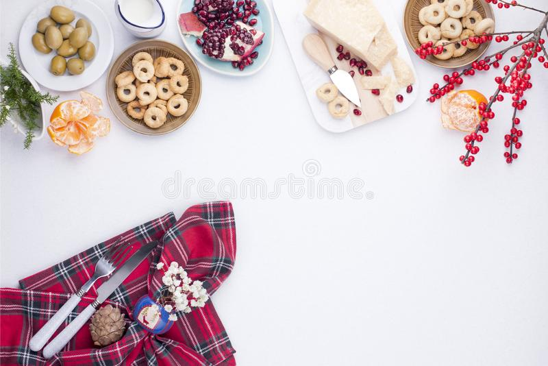 Table with different food for the Christmas party on the white t royalty free stock photo