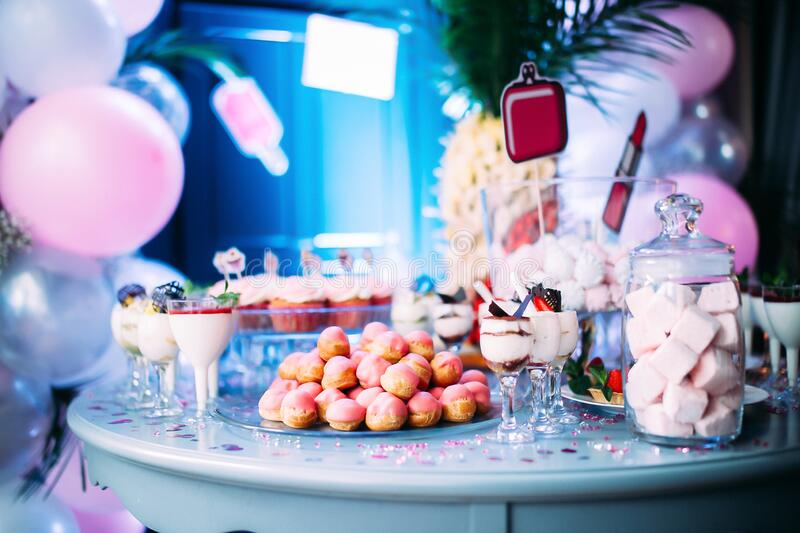 Beautifully decorated table with different cakes and sweets. A table with different sweets at the theme party in honor of the birthday of the childn royalty free stock images