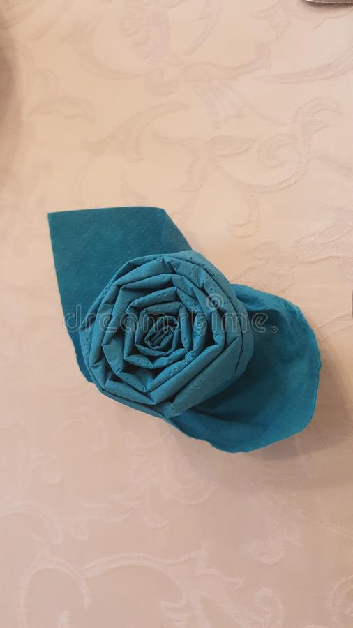 Napkin folded decor on holly day family meeting. Table dressing decor napkin folded royalty free stock image