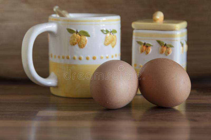 Table with eggs, cup for breakfast and sugar leads stock photos
