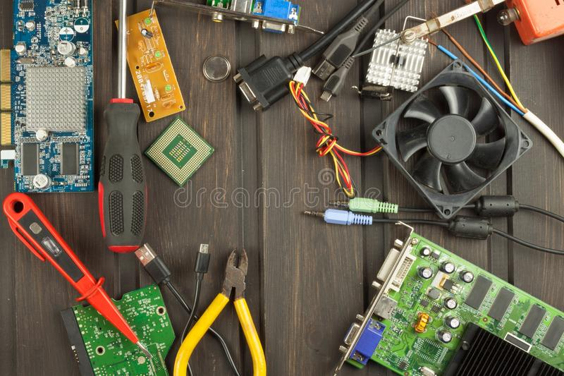 Table electronics repairman. Home computer repair. Desktop clutter electronics repairman. Recycling of multiple computers. Sales of electronic parts royalty free stock photo