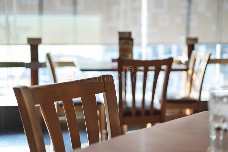 Table and empty chair Interior of a modern restaurant or bar royalty free stock image