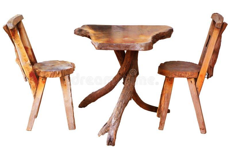 Table en bois avec des chaises d'isolement photographie stock libre de droits