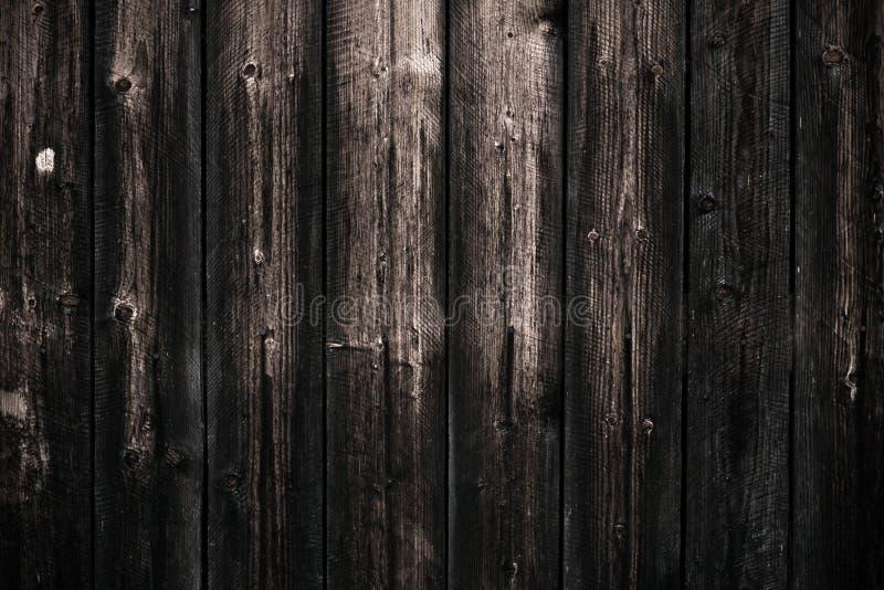 Table en bois minable foncée sale Fond en bois noir de texture de barrière Modèle en bois, surface Plancher en bois de vintage de image libre de droits
