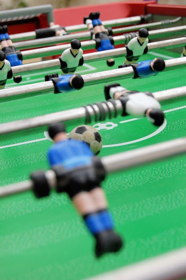 Table et joueurs de football images stock