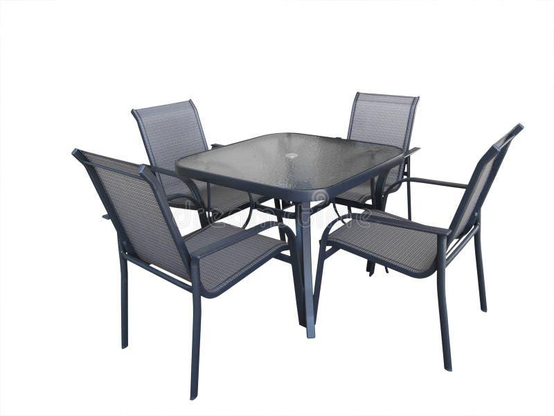 Table et présidences en verre extérieures photos stock