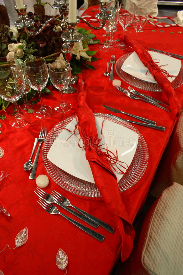Table for the feast. Red tablecloth on the table for the feast royalty free stock photography