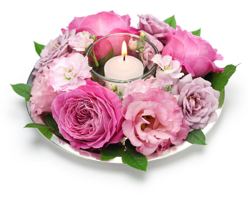 Table flower arrangement with candle royalty free stock photo