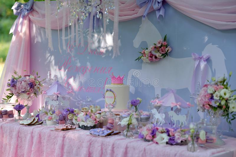 Table with flowers and a dessert. Holiday table with delicate decorations, bouquets of flowers and dessert royalty free stock photos