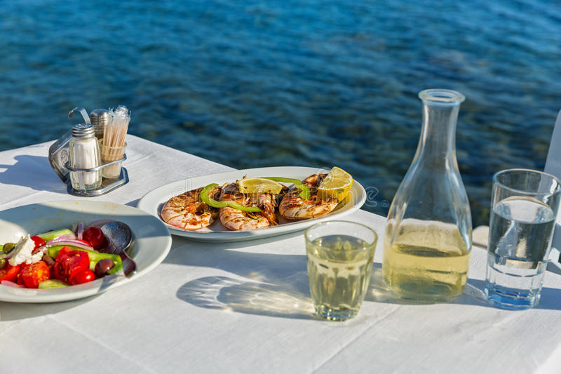 Table with food and wine stock images