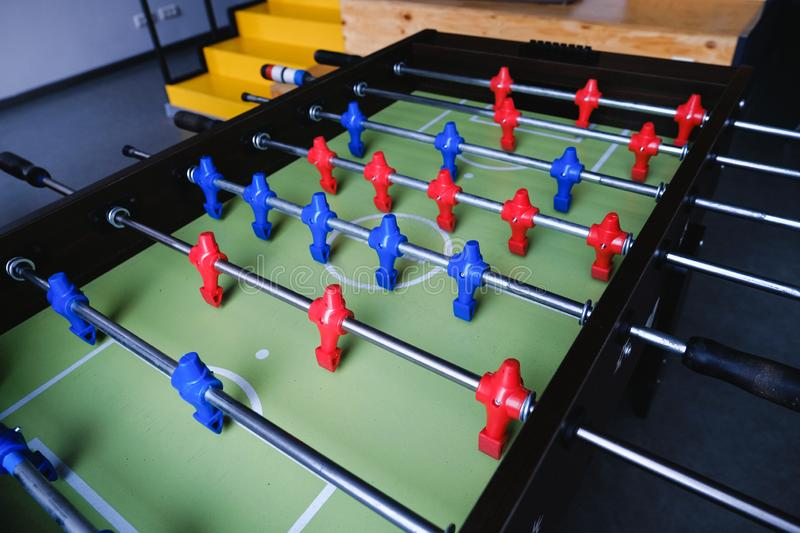 Table football in the entertainment center. Close-up image of plastic players in a football game stock photography