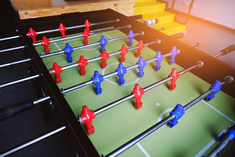 Table football in the entertainment center. Close-up image of plastic players in a football game stock photo