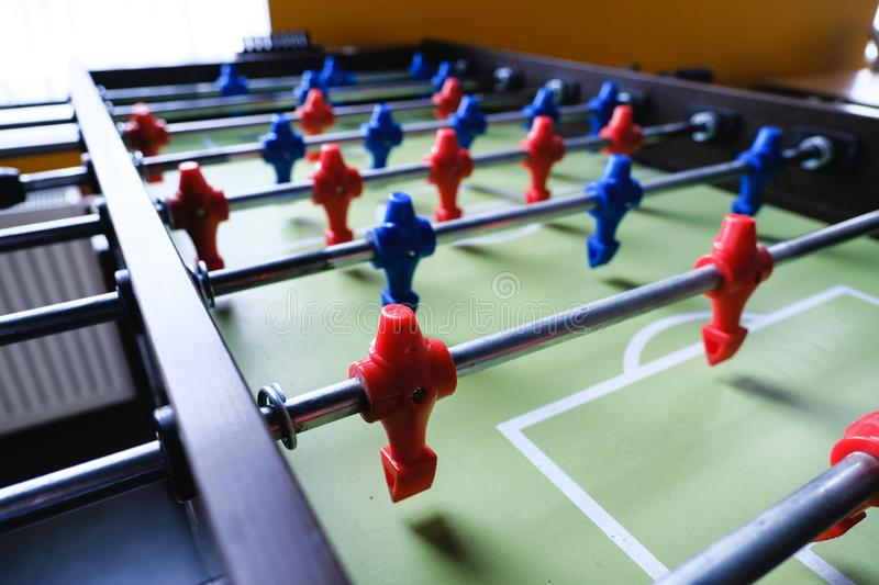 Table football in the entertainment center. Close-up image of plastic players in a football game royalty free stock image