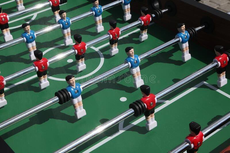 Table football game. Soccer table figures, dressed in yellow and blue. could be a nice symbol for teamwork.. royalty free stock photos