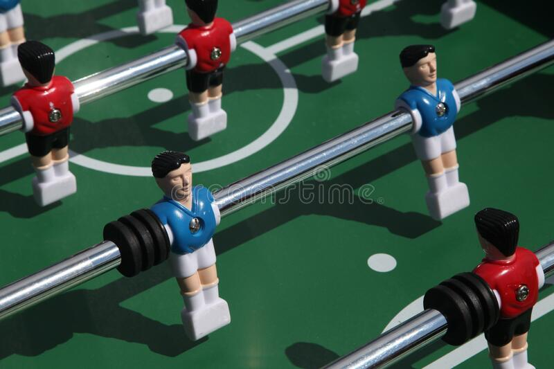 Table football game. Soccer table figures, dressed in yellow and blue. could be a nice symbol for teamwork.. stock photo