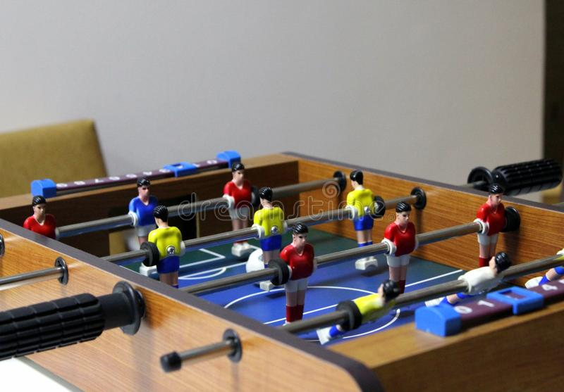 Table football soccer game. kicker. sports team players in red and yellow t-shirts royalty free stock photography