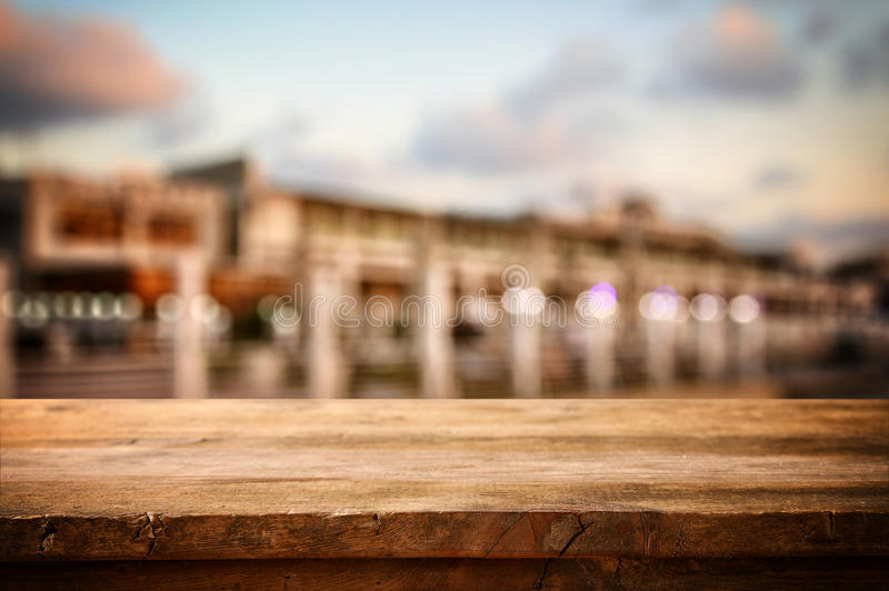 Table in front of abstract blurred background of restaurant view. Image of wooden table in front of abstract blurred background of restaurant view stock photos