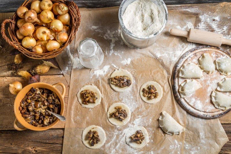 Table full of ingredients for homemade dumplings stock photo
