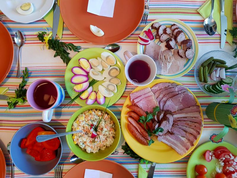 Table full of tasty food seen from above. Traditional natural easter family meal, easter brunch concept royalty free stock image