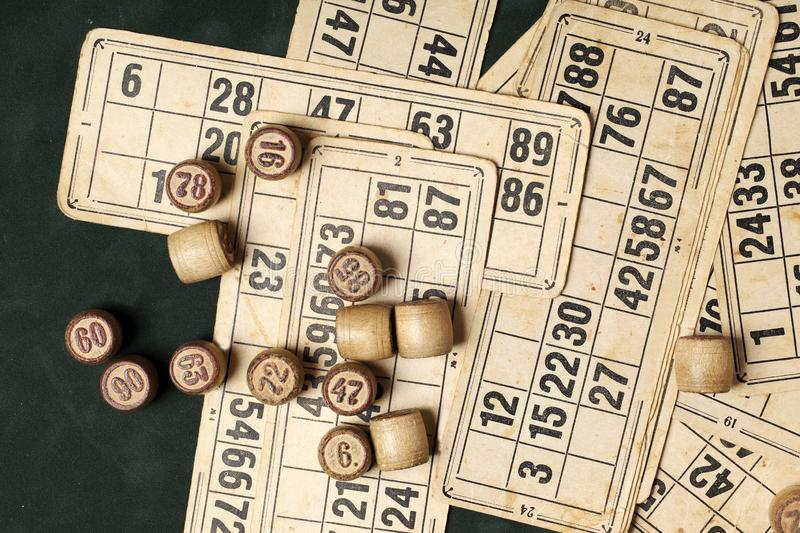 Table game Bingo. Wooden Lotto barrels with bag, playing cards for Lotto games, games for family. Table game Bingo. Wooden Lotto barrels with bag, playing cards royalty free stock images