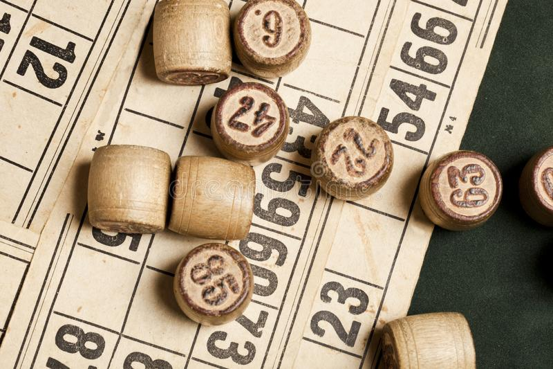 Table game Bingo. Wooden Lotto barrels with bag, playing cards for Lotto games, games for family. Table game Bingo. Wooden Lotto barrels with bag, playing cards stock photography