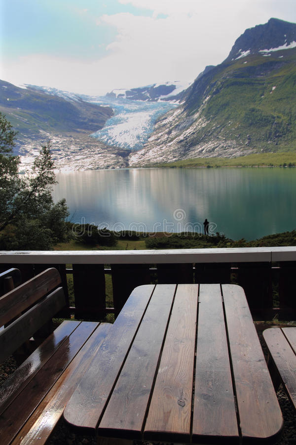 Table and glacier. Benches and tables in front of Svartisen Glacier, the lowest glacier of europe, only 25 mts above sea Level stock images