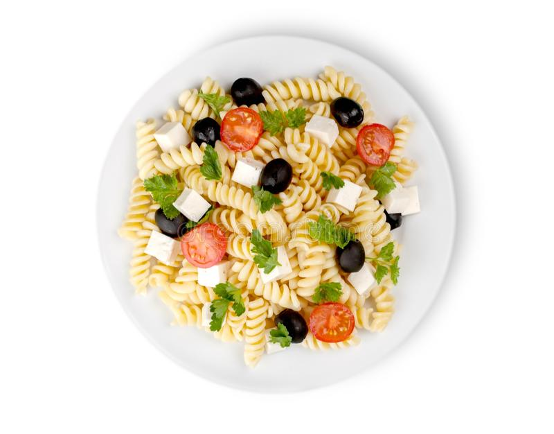 Italian pasta with tomatoes, olives and cheese royalty free stock photography