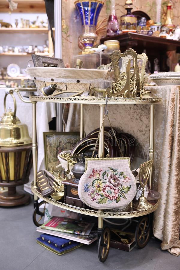 Table with a handbag among different vintage things stock photo