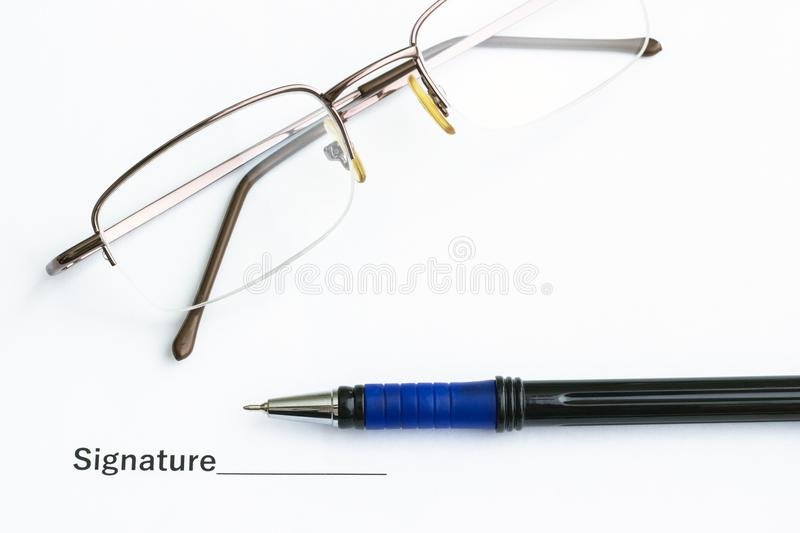 On the table is an important document, pen and glasses stock photography