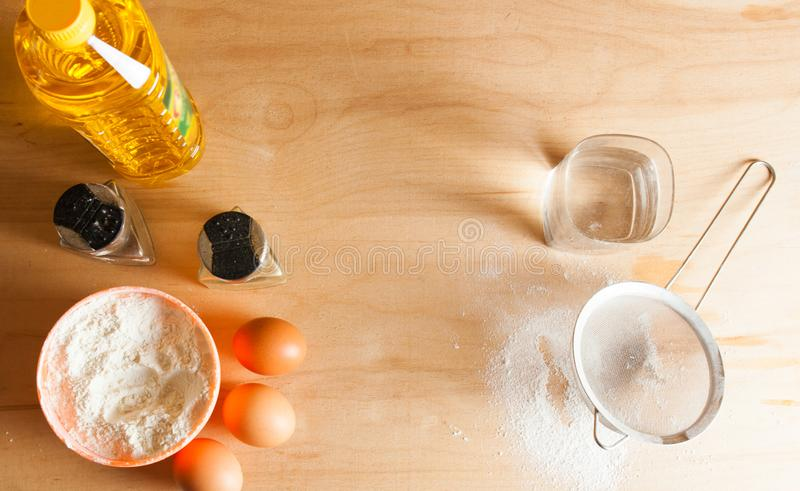 Table with ingredients for making dough. Close up stock photos