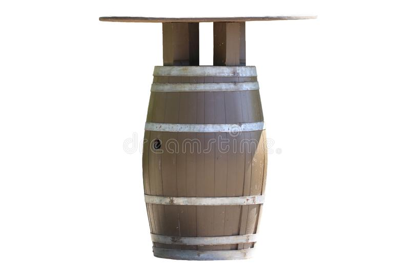 Table isolated. A brown wooden barrel for wine with iron rings u. Sed as table in the outdoor area in a leisure park isolated on a white background royalty free stock photography
