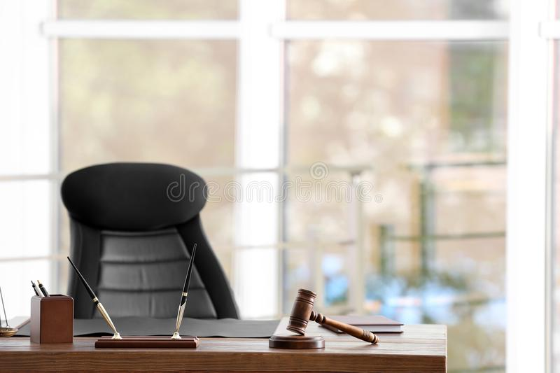 Table with judge gavel in lawyer`s stock photo