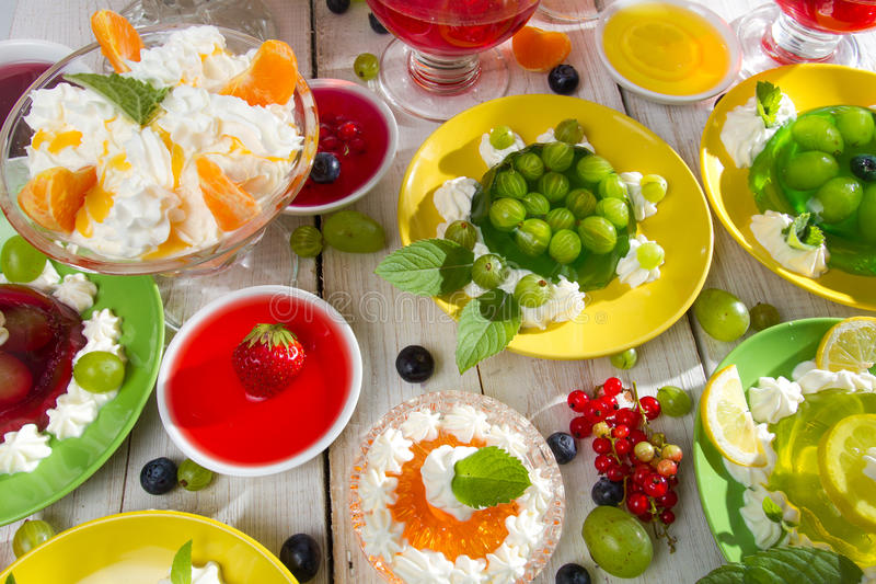 Table laden with various kinds of jellies stock images