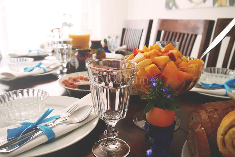 Table laid with food for breakfast royalty free stock image