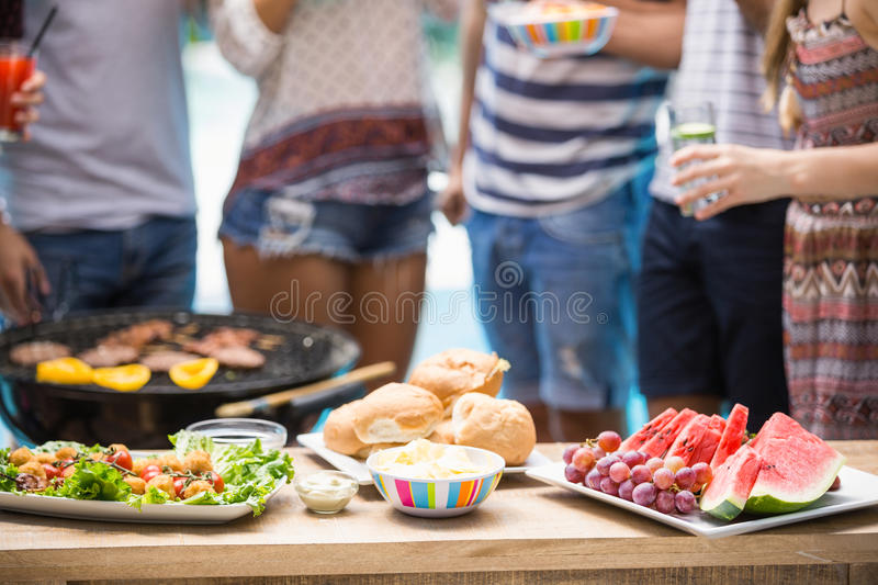 Table laid with food for outdoors barbecue party royalty free stock photos