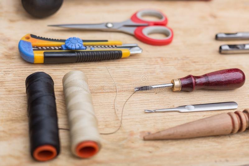 Tools for working with leather goods. On the table laid out tools for working with leather goods. Master class on making leather accessories. Handmade clothes royalty free stock images