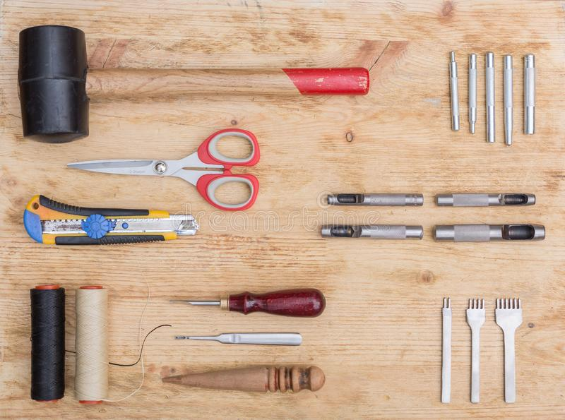 Tools for working with leather goods. On the table laid out tools for working with leather goods. Master class on making leather accessories. Handmade clothes royalty free stock photography
