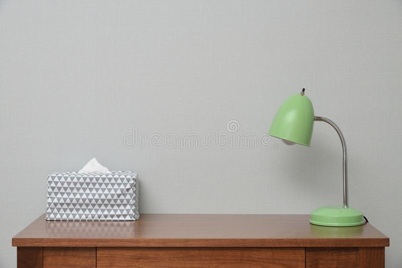 Table with Lamp and Tissue stock photography