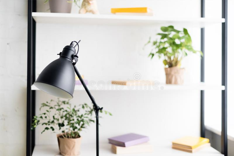 Table lamp on work desk. At modern aparment royalty free stock images