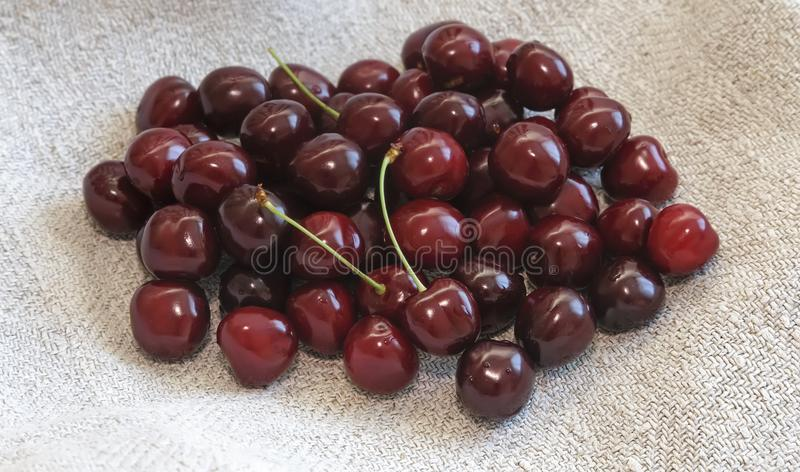 Ripe cherries on the table on a napkin. royalty free stock image