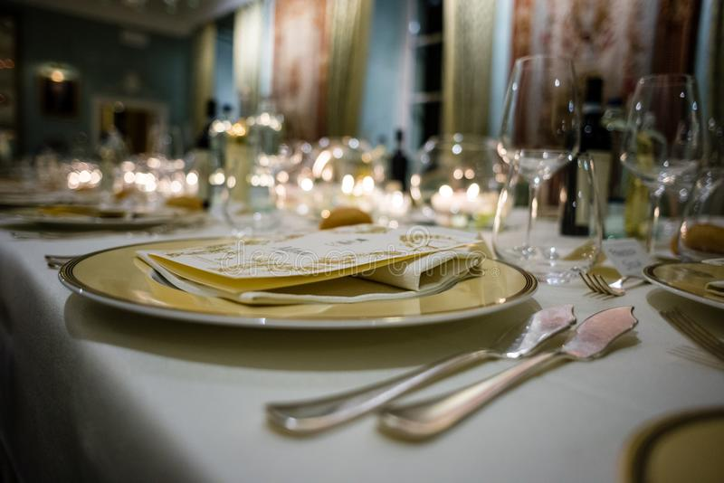 Table in a luxury restaurant, set for a gala dinner. On the table various candles royalty free stock photography